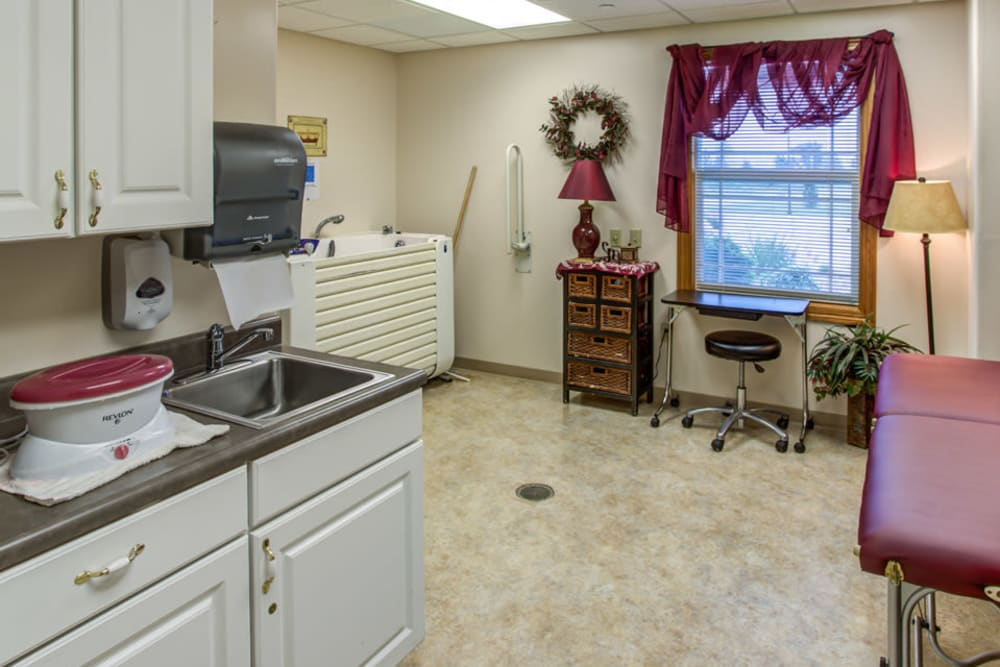 Resident spa with whirlpool tub and massage table at SunnyBrook Carroll in Carroll, Iowa.