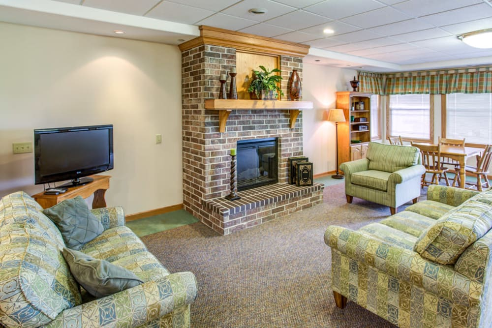 Comfortable lounge with fireplace and TV at SunnyBrook Carroll in Carroll, Iowa.