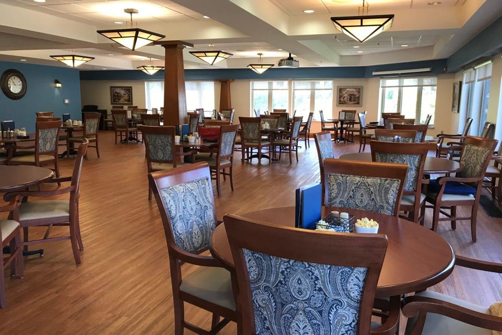 Spacious and brightly lit dining room at Prairie Hills Cedar Rapids in Cedar Rapids, Iowa.