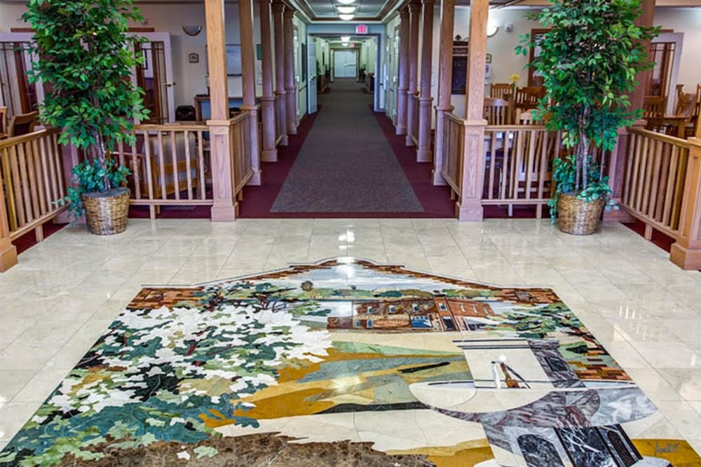 Main lobby with tile mosaic at Prairie Hills Senior Living in Des Moines, Iowa.