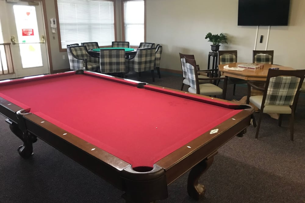 Activity room with pool table at Prairie Hills Senior Living in Des Moines, Iowa.