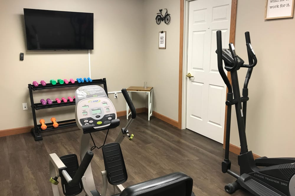 Exercise room with equipment at Prairie Hills Senior Living in Des Moines, Iowa.