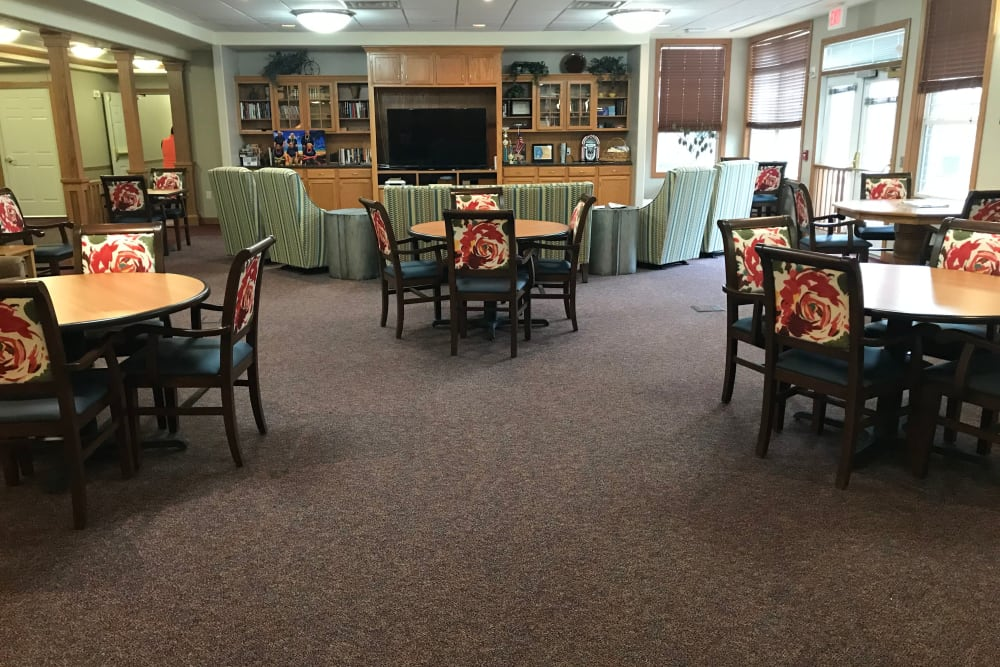 Large activity room with big screen TV at Prairie Hills Senior Living in Des Moines, Iowa