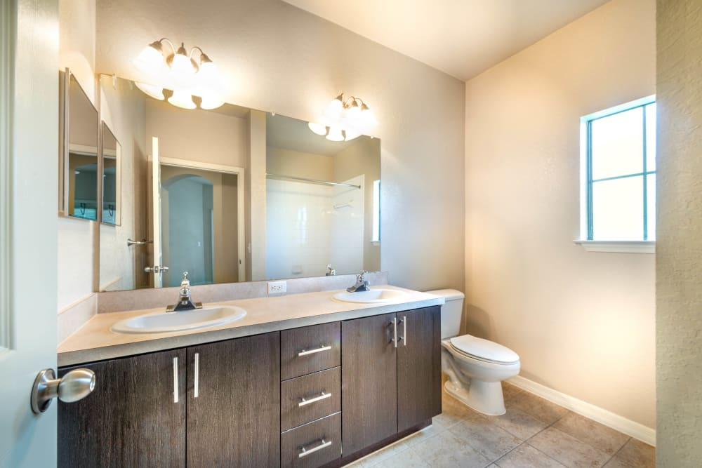 Granite countertop in a model apartment's bathroom at Mirador & Stovall at River City in Jacksonville, Florida