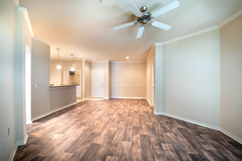 Ceiling fan and hardwood flooring in the living area of a model apartment at Mirador & Stovall at River City in Jacksonville, Florida