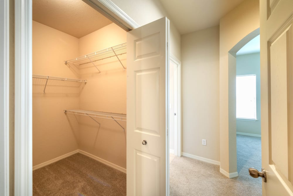 Spacious walk-in closet in a model home at Mirador & Stovall at River City in Jacksonville, Florida