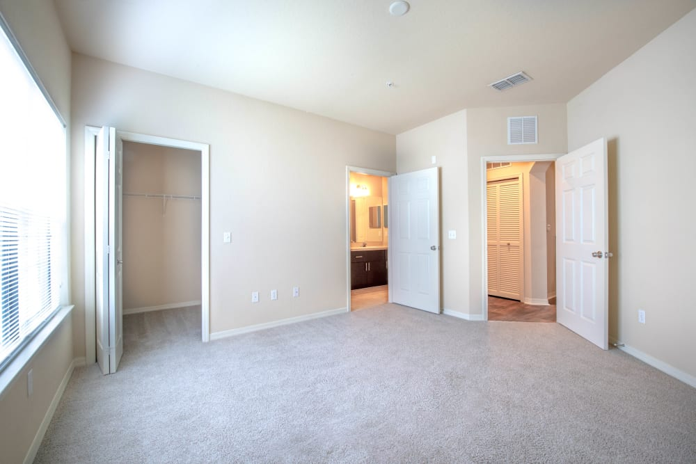 Plush carpeting throughout the large master bedroom of a model home at Mirador & Stovall at River City in Jacksonville, Florida