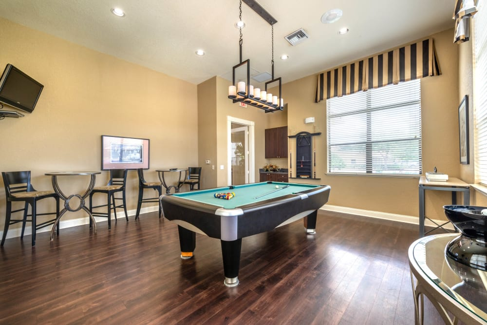 Game room with billiards in the clubhouse at Mirador & Stovall at River City in Jacksonville, Florida