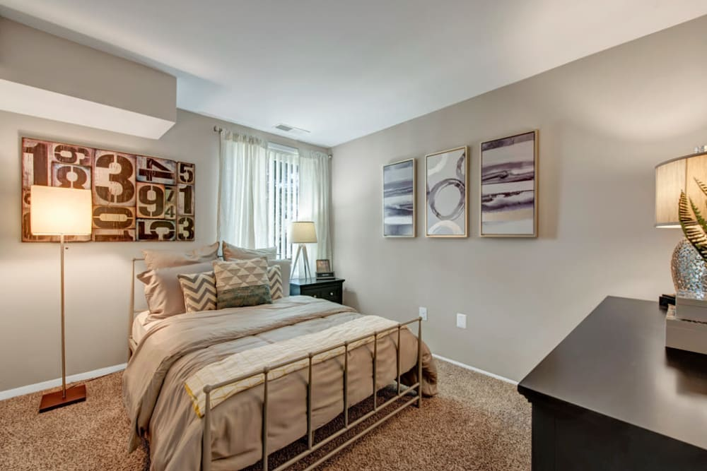 A spacious apartment bedroom at Cinnamon Run at Peppertree Farm in Silver Spring, Maryland