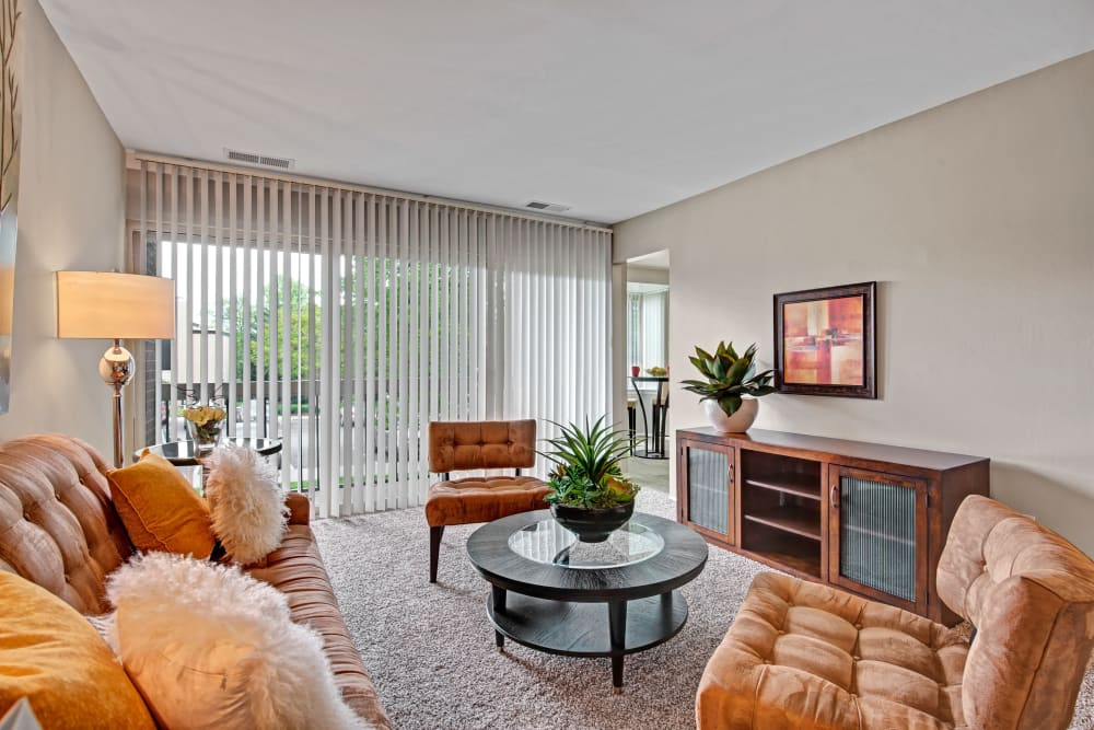 An inviting apartment living room at Cinnamon Run at Peppertree Farm in Silver Spring, Maryland