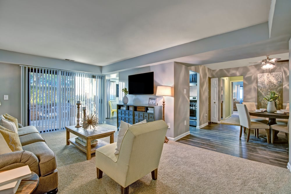 Spacious living room with patio access at The Gateway in Gaithersburg, Maryland
