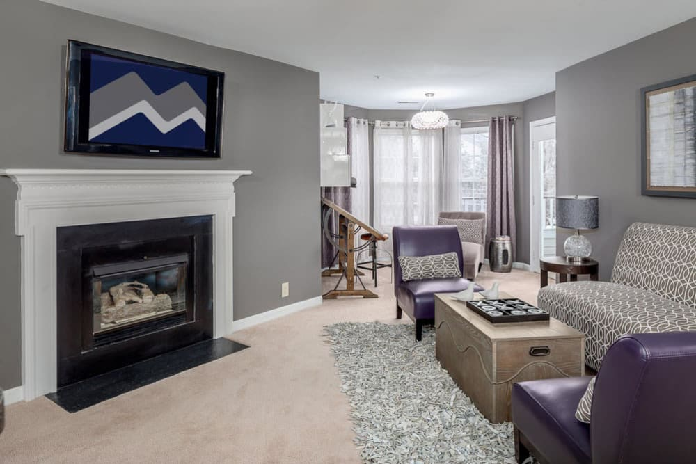 Living room with a fireplace at Sussex at Kingstowne in Alexandria, Virginia