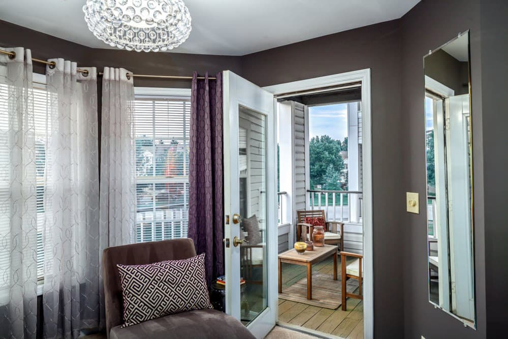 Living room with patio access at Sussex at Kingstowne in Alexandria, Virginia