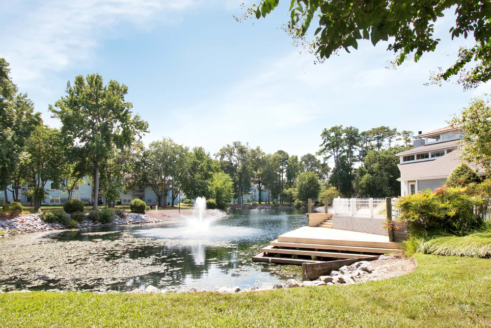 Pond with a stunning water feature at Runaway Bay Apartments in Virginia Beach, Virginia