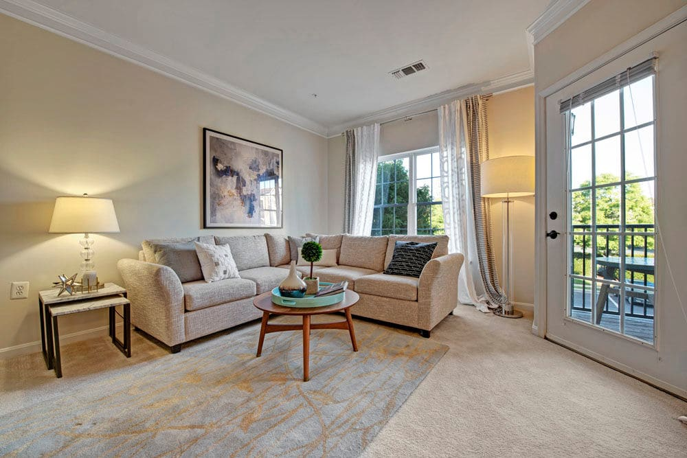 Living room with patio access at Dulles Greene in Herndon, Virginia