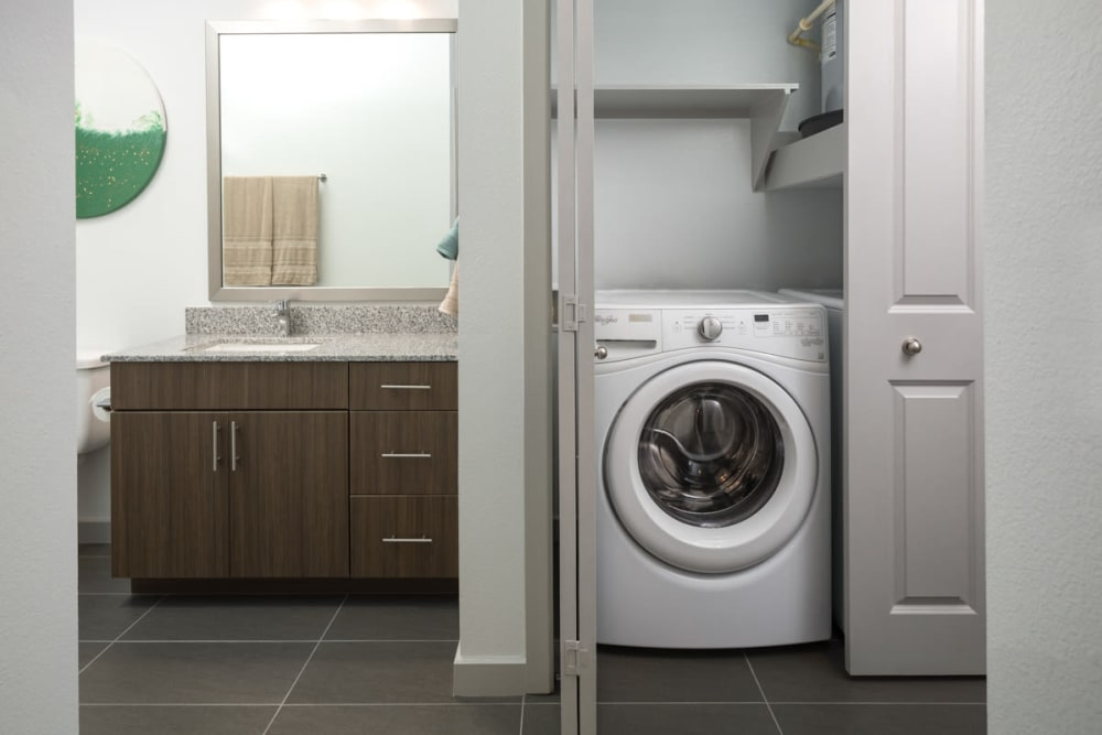 In-unit washer and dryer in a model apartment at Lux on Main in Carrollton, Texas