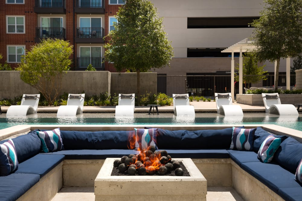 Fire pit near the pool at Olympus on Main in Carrollton, Texas