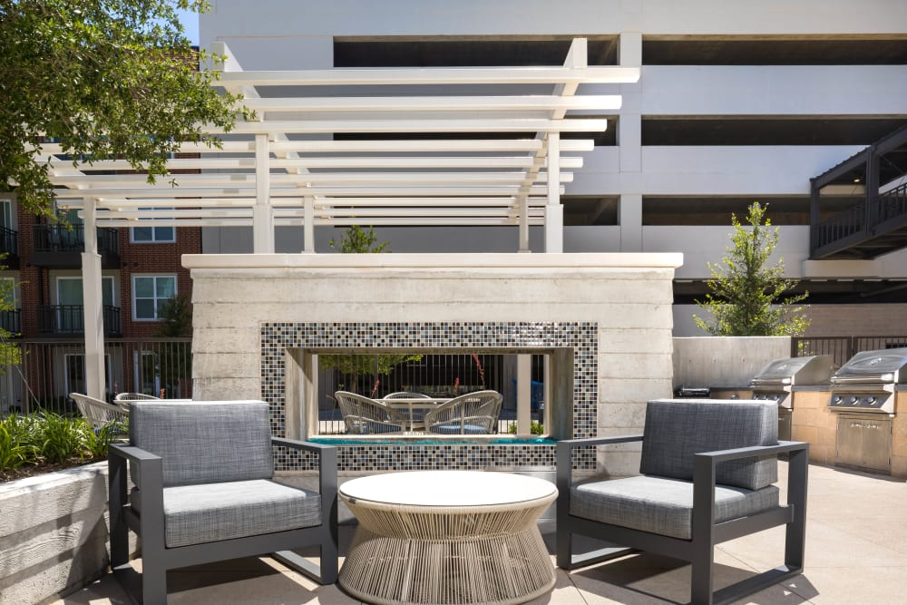 Lounge area in the exterior courtyard at Lux on Main in Carrollton, Texas