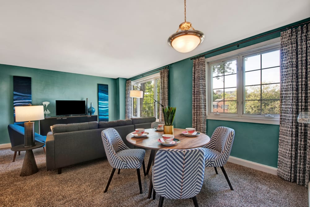 A decorated apartment living room and dining room at Braddock Lee Apartments in Alexandria, Virginia