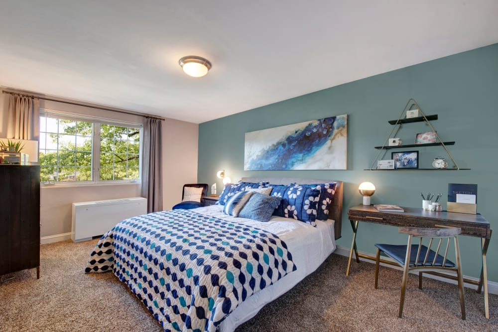 A spacious, decorated apartment bedroom at Braddock Lee Apartments in Alexandria, Virginia