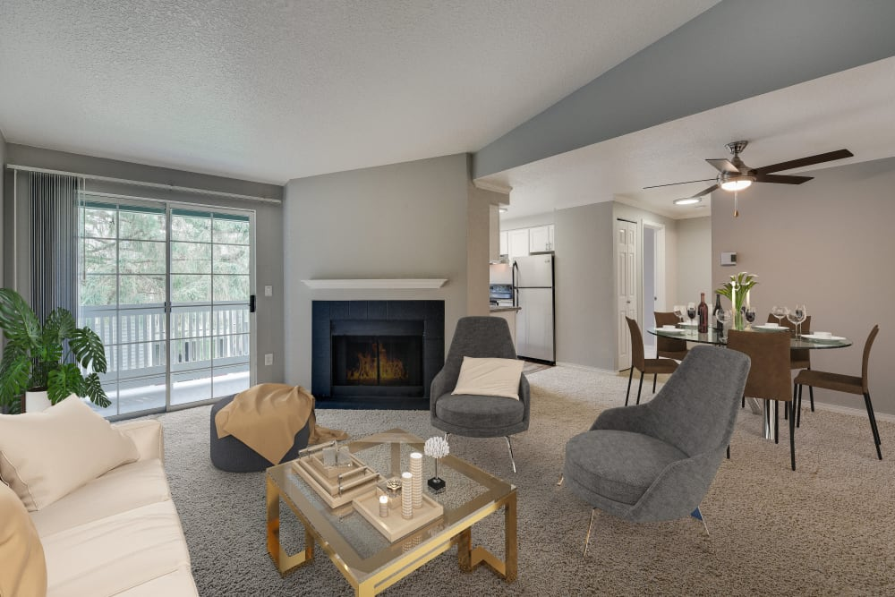 Kitchen and living area view with fireplace, open floorplan at Walnut Grove Landing Apartments in Vancouver, WA
