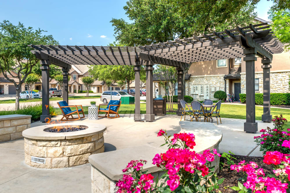 Fire pit area surrounded by well-maintained flora at Olympus Town Center in Keller, Texas
