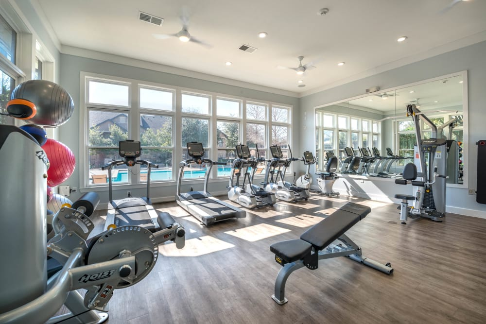 Well-equipped onsite fitness center at Olympus Town Center in Keller, Texas
