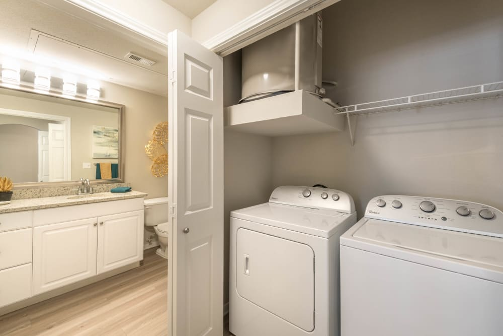 Full-size in-unit washer and dryer in a model home at Olympus Town Center in Keller, Texas