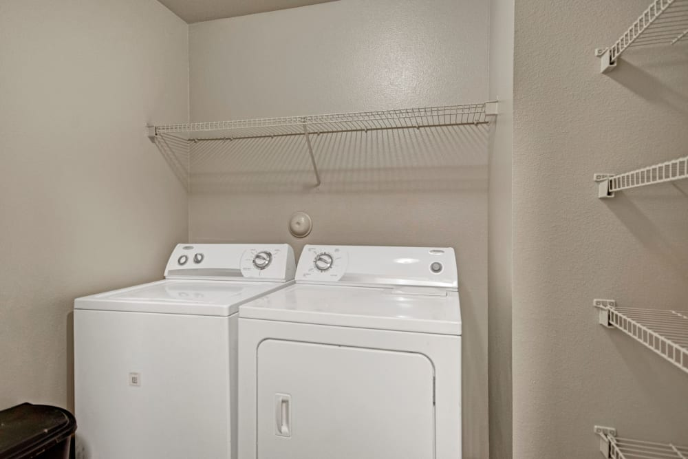 In-home washer and dryer at Vista 121 Apartment Homes in Lewisville, Texas
