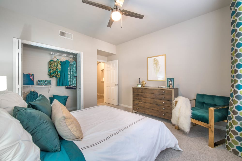Plush carpeting and a large closet in the master bedroom of a model home at Olympus Town Center in Keller, Texas