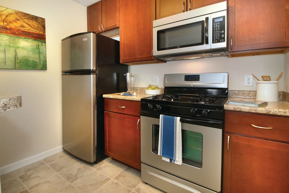 Stainless steel appliances in a model apartment kitchen at The Commons At Haynes Farm in Shrewsbury, Massachusetts