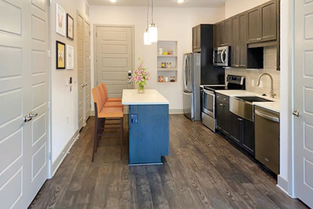 Kitchen with hardwood flooring at Alta Trinity Green in Dallas, Texas