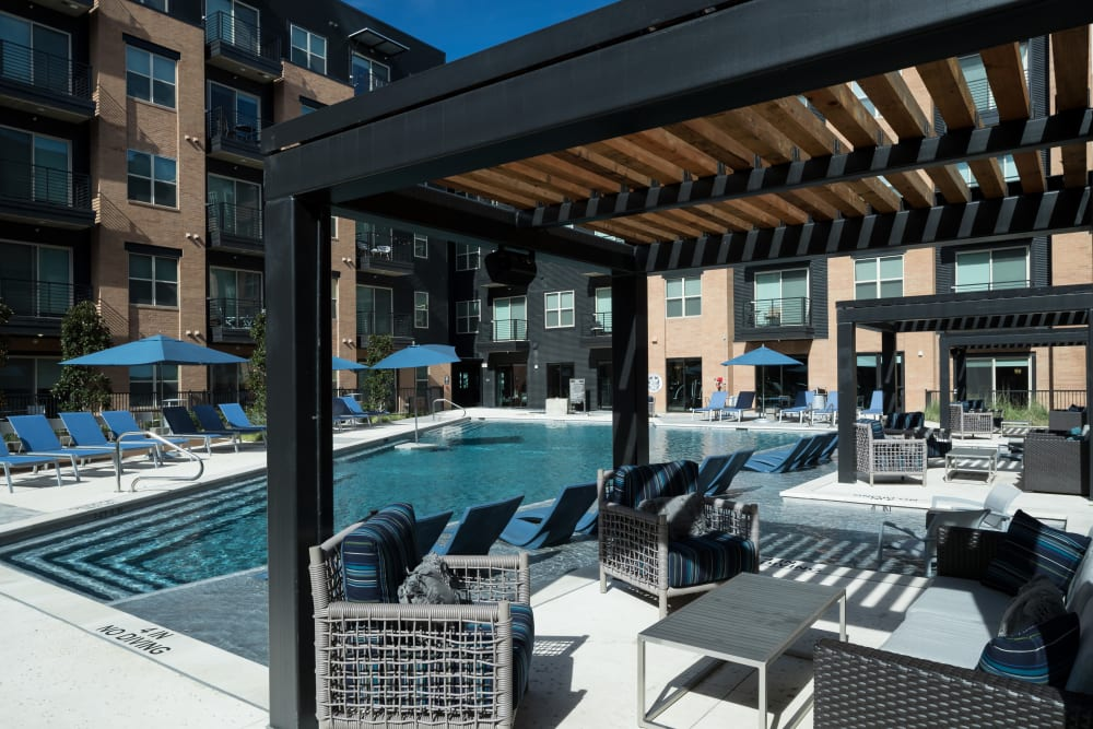 Enjoy the pool and outdoor seating at Alta Trinity Green in Dallas, Texas