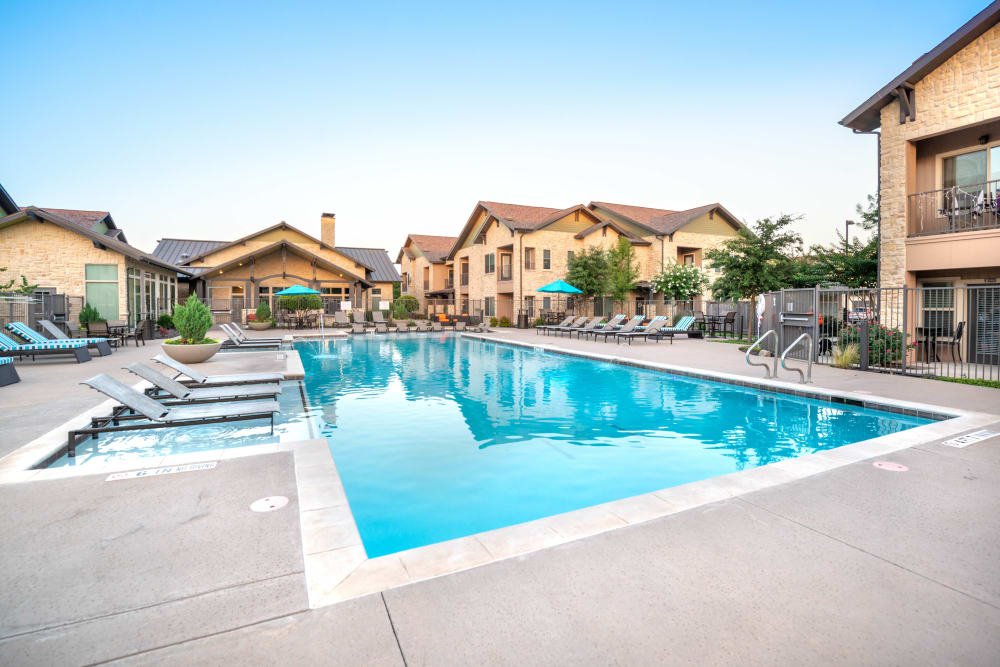 Resort-style swimming pool on a beautiful morning at Olympus Waterford in Keller, Texas