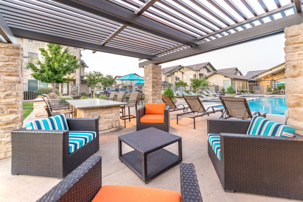 Modern pergola over one of the outdoor lounge areas at Olympus Waterford in Keller, Texas