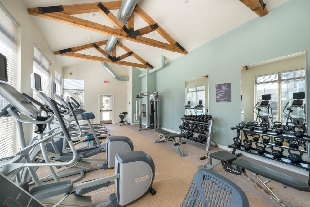 Well-equipped onsite fitness center at Olympus Waterford in Keller, Texas