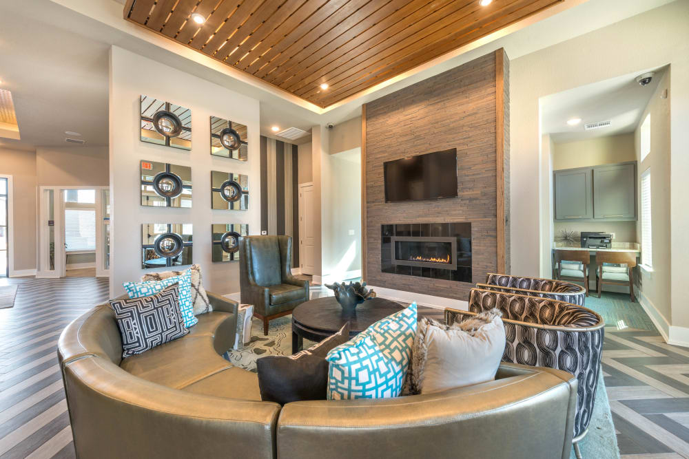 Lounge area in front of the fireplace in the clubhouse lounge at Olympus Waterford in Keller, Texas