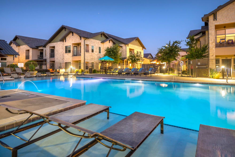 Twilight at the swimming pool area at Olympus Waterford in Keller, Texas
