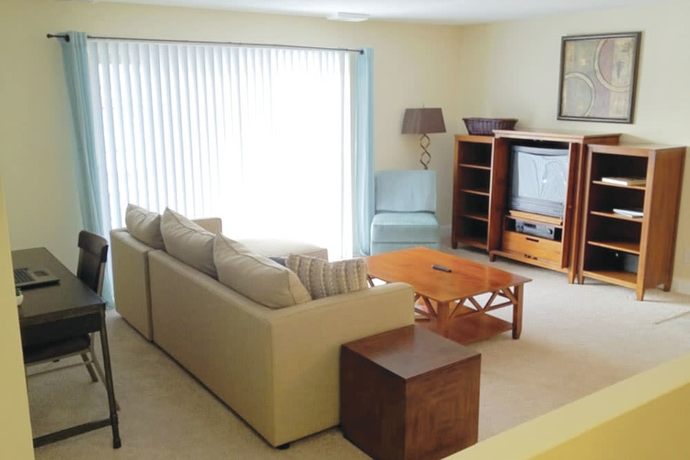 A living room with tv and couch at The Heights At Marlborough in Marlborough, Massachusetts