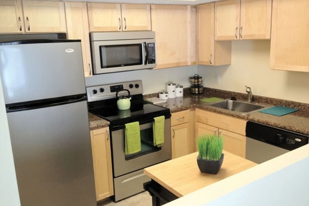 A large kitchen with new appliances at The Heights At Marlborough in Marlborough, Massachusetts