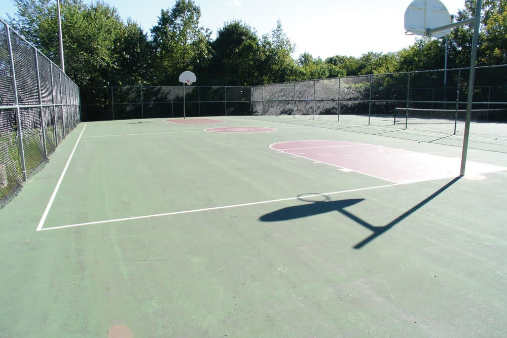 An outdoor basketball court at The Heights At Marlborough in Marlborough, Massachusetts