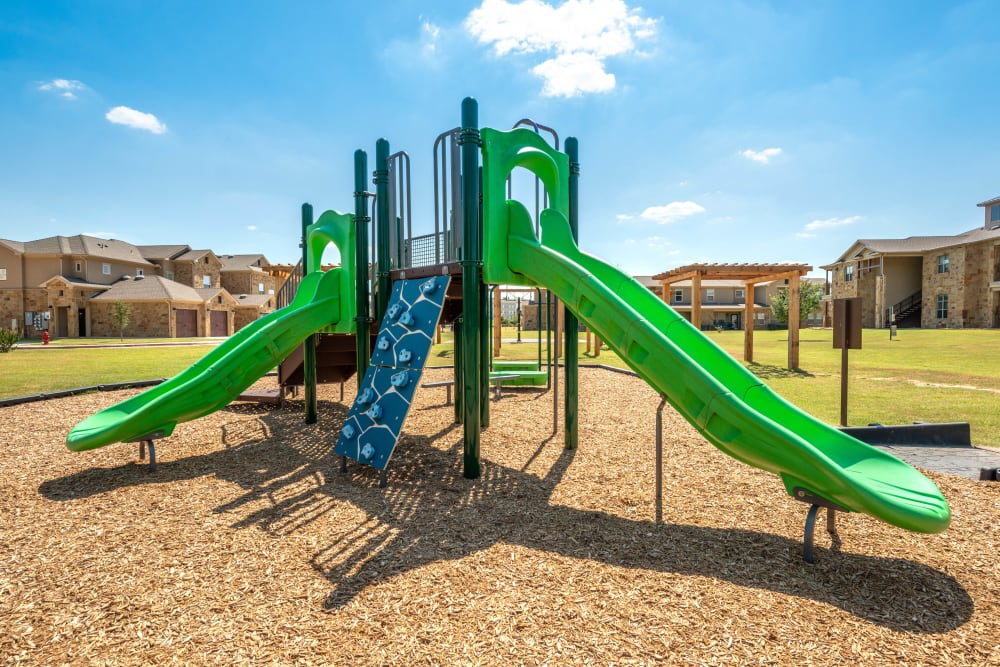 Onsite children's playground at Olympus Willow Park in Willow Park, Texas