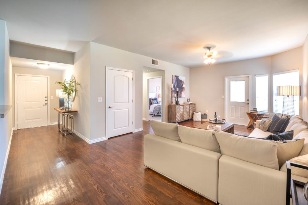 Beautiful hardwood flooring throughout the living areas in a model home at Olympus Willow Park in Willow Park, Texas