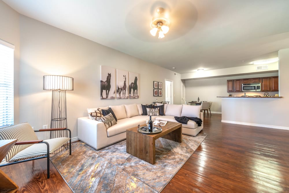 Beautiful hardwood floors in the living areas of a model home at Olympus Willow Park in Willow Park, Texas