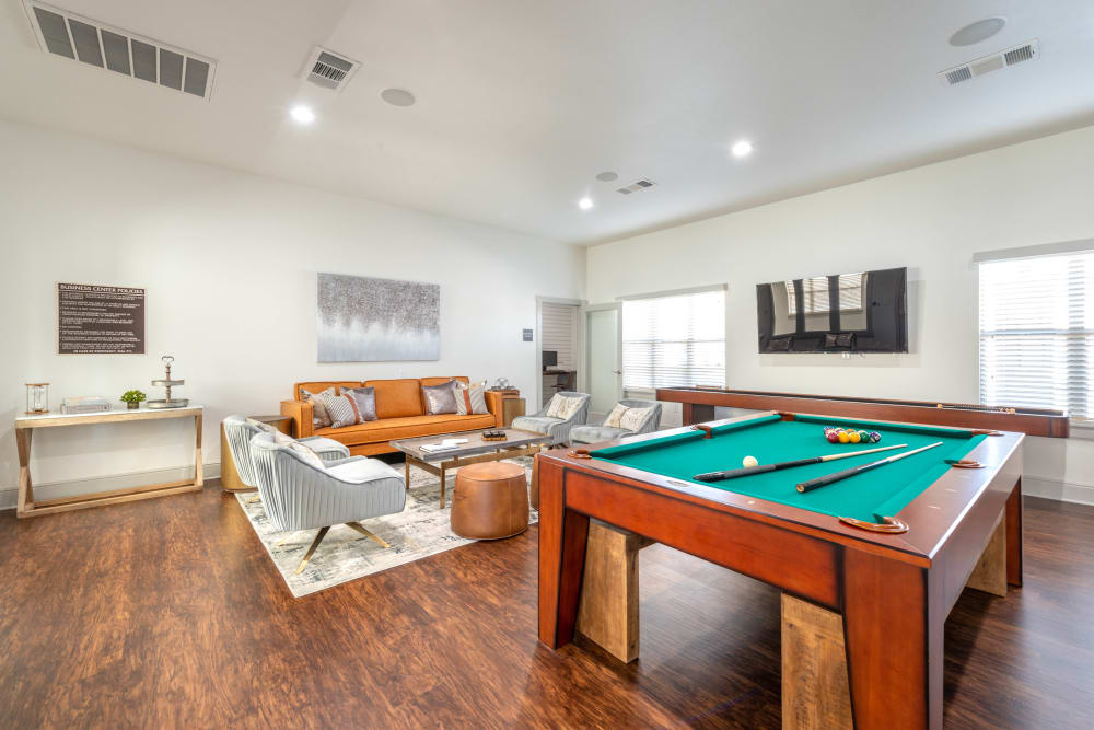 Game room in the clubhouse with billiards and more at Olympus Willow Park in Willow Park, Texas