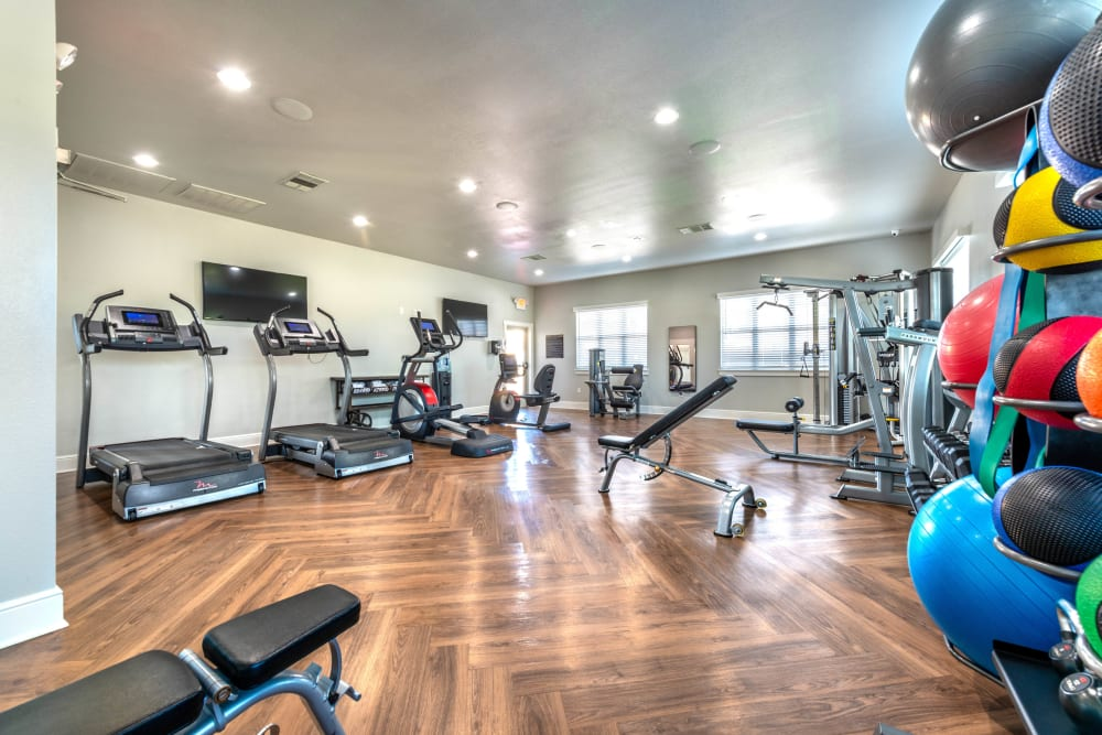 Well-equipped fitness center at Olympus Willow Park in Willow Park, Texas