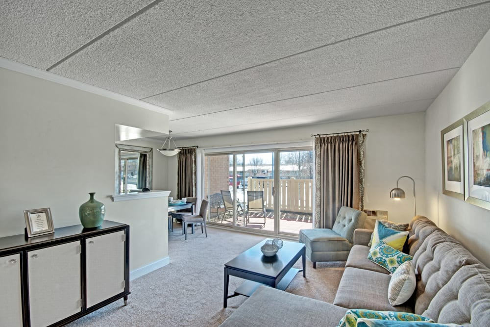 Living room In an apartment at Golf Club Apartments in West Chester, Pennsylvania features couch with stylish area rug