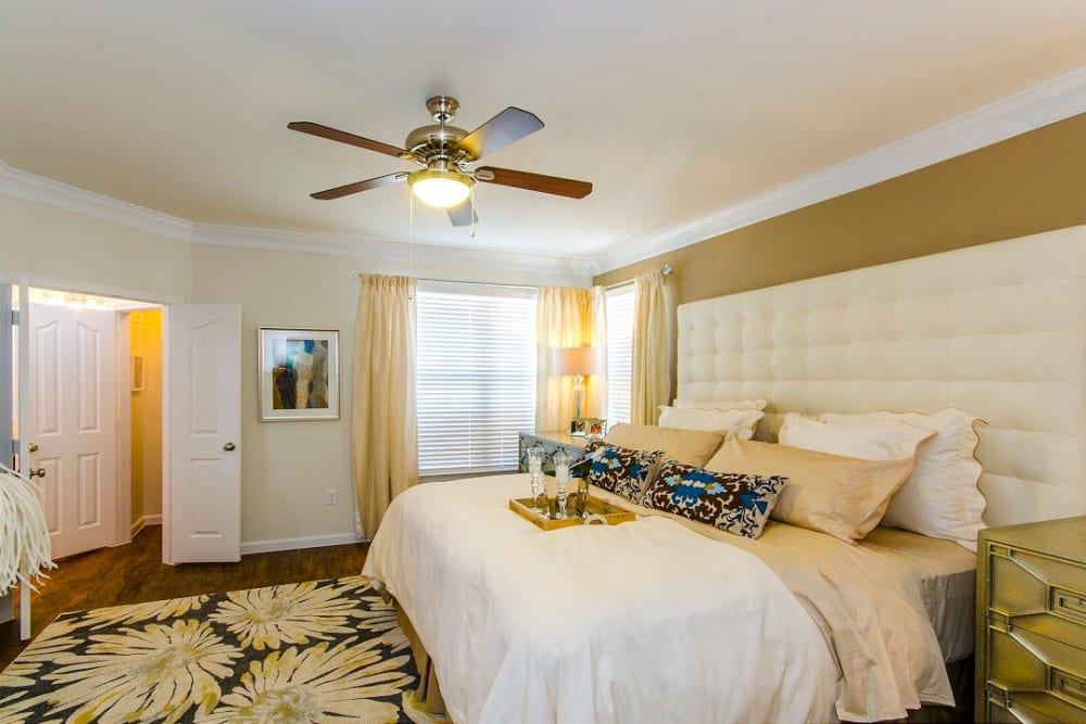 Very well-furnished model home's master bedroom at Olympus Woodbridge in Sachse, Texas