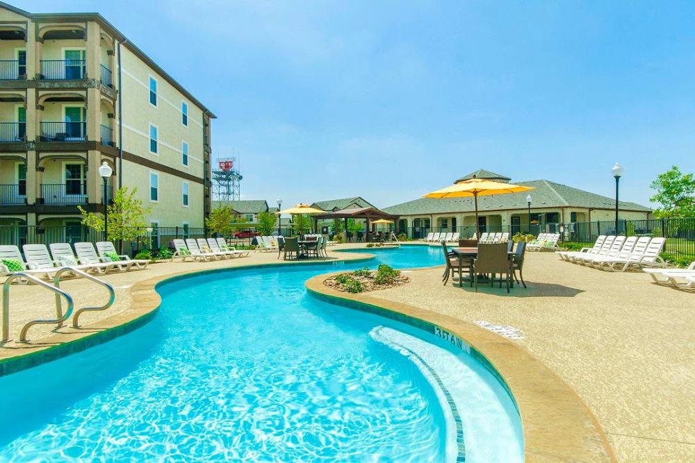 Beautiful resort-style swimming pool area at Olympus Woodbridge in Sachse, Texas