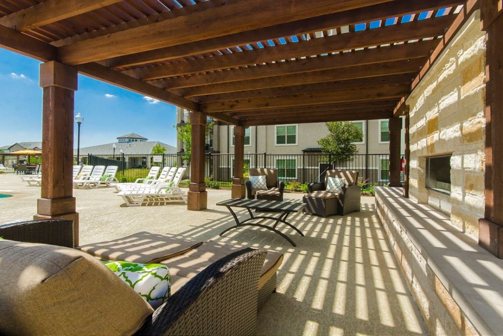 Extensive pergola providing partial shade at an outdoor lounge area at Olympus Woodbridge in Sachse, Texas